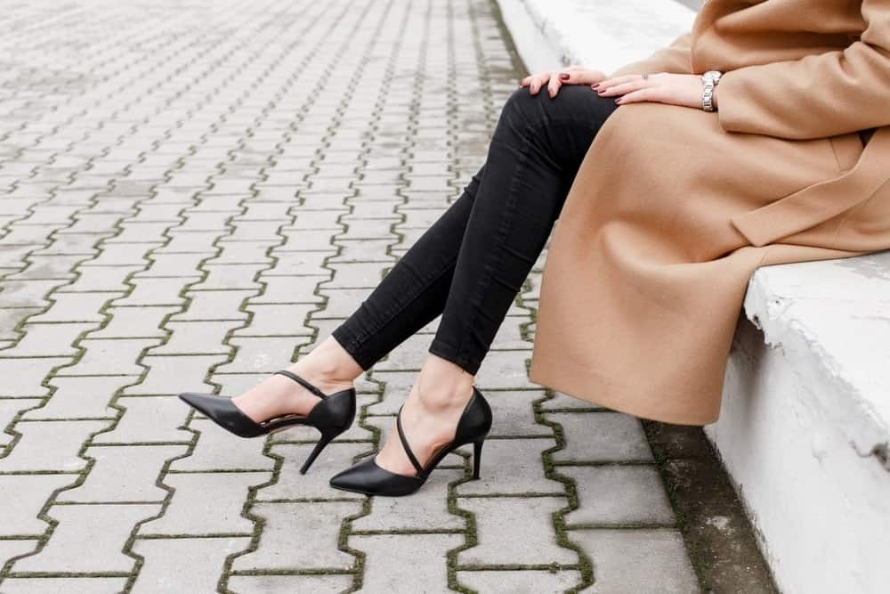 woman on street wearing black high heels