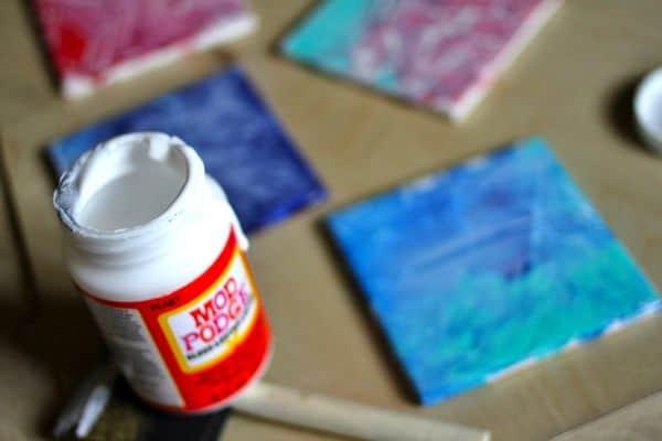 DIY_saranwrap_painted_coasters_modpodge