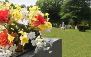 bright flowers on a tombstone