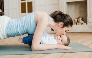 young mom exercising with her baby