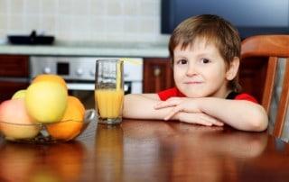 boy with glass of orange juice