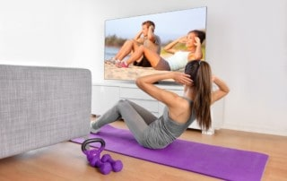 young woman working out at home