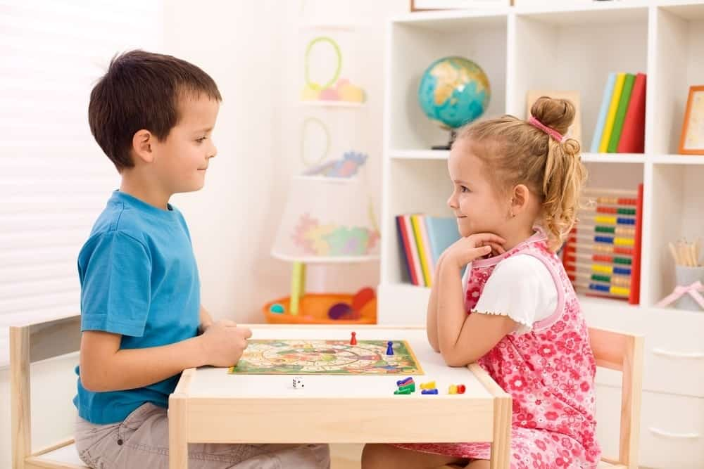 boy and girl playing board game