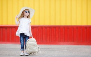 Little girl waiting with her backpack