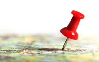 Red thumbtack on a map indicating a destination