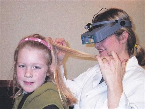 mom coming daughter's hair
