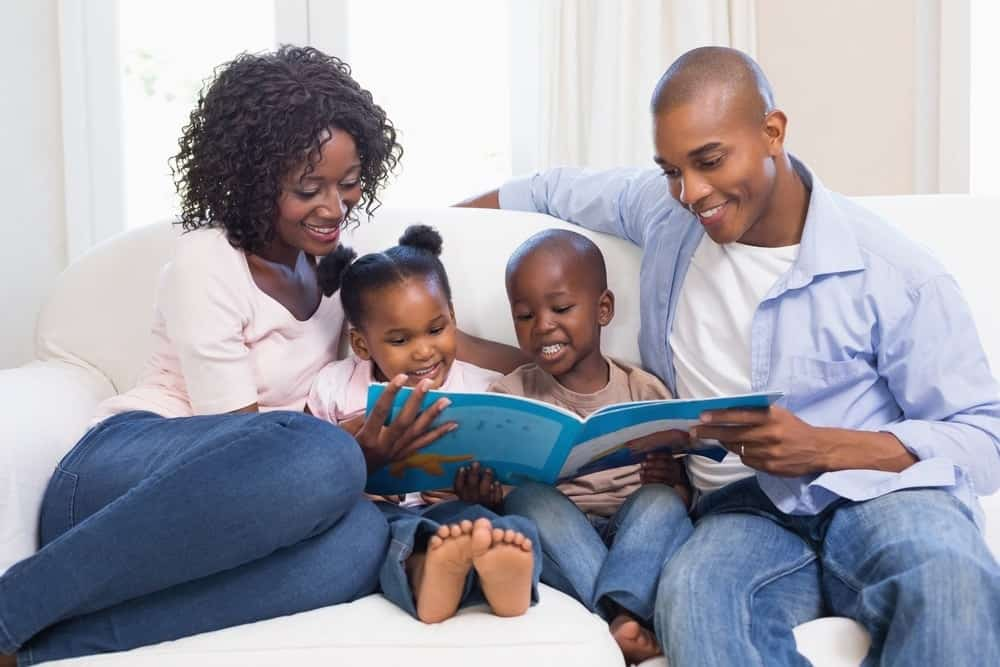 mom and dad reading with young children