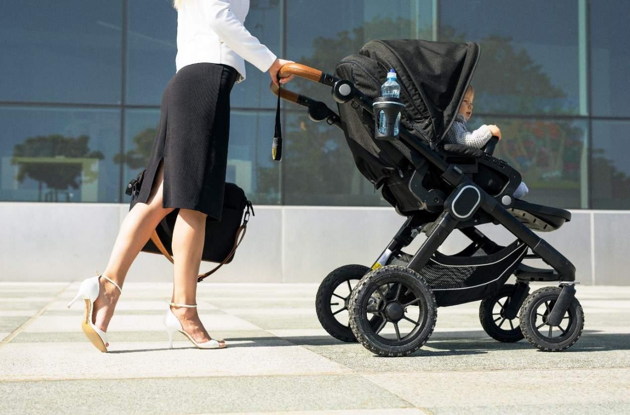 mother in heels pushing stroller