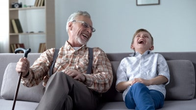 old man and boy laughing at silly jokes